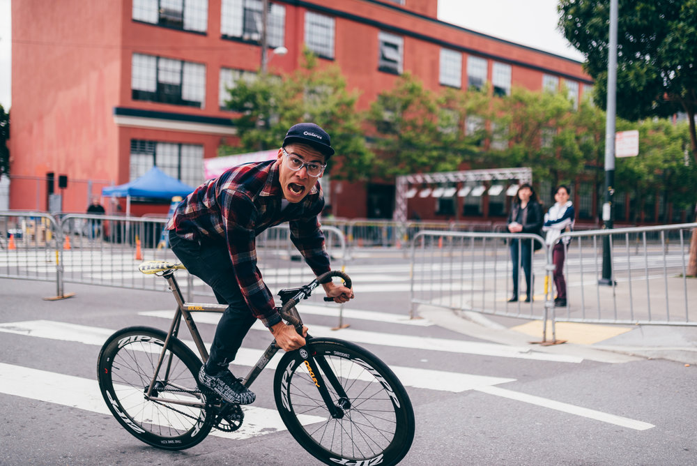 chas christiansen cycling in action through the streets