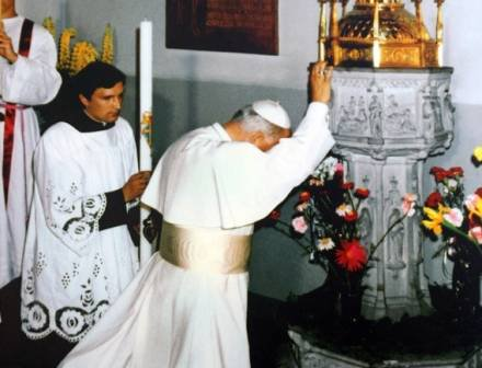 Pope Saint John Paul II at his baptismal font   image via  @ChurchinPoland