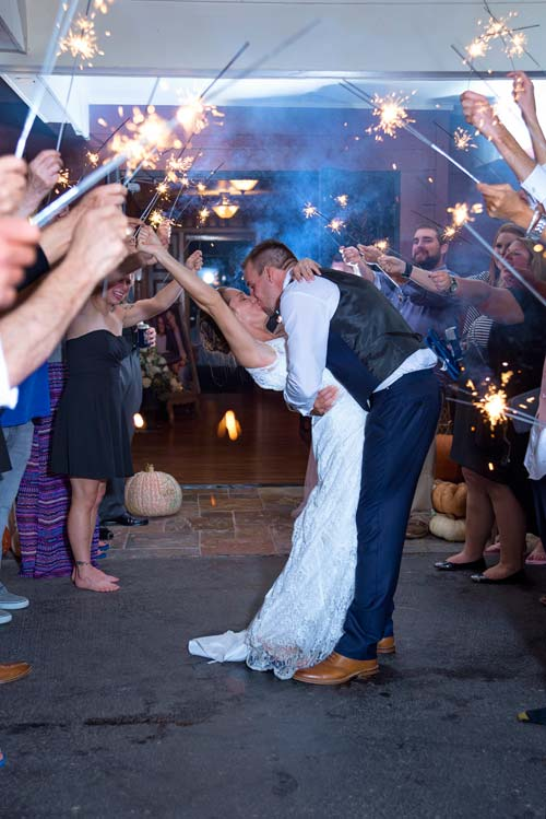 Wedding-Exit-Bride-Groom-Kissing-Farewell-Fireworks.jpg