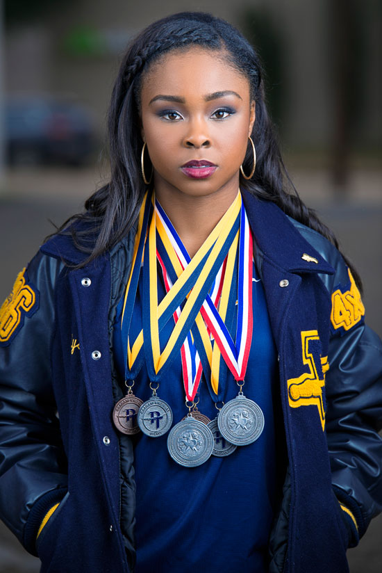 Longview-Texas-Senior-Photographer-Kris-Spelce-Athlete-Track-Pretty-Medals.jpg