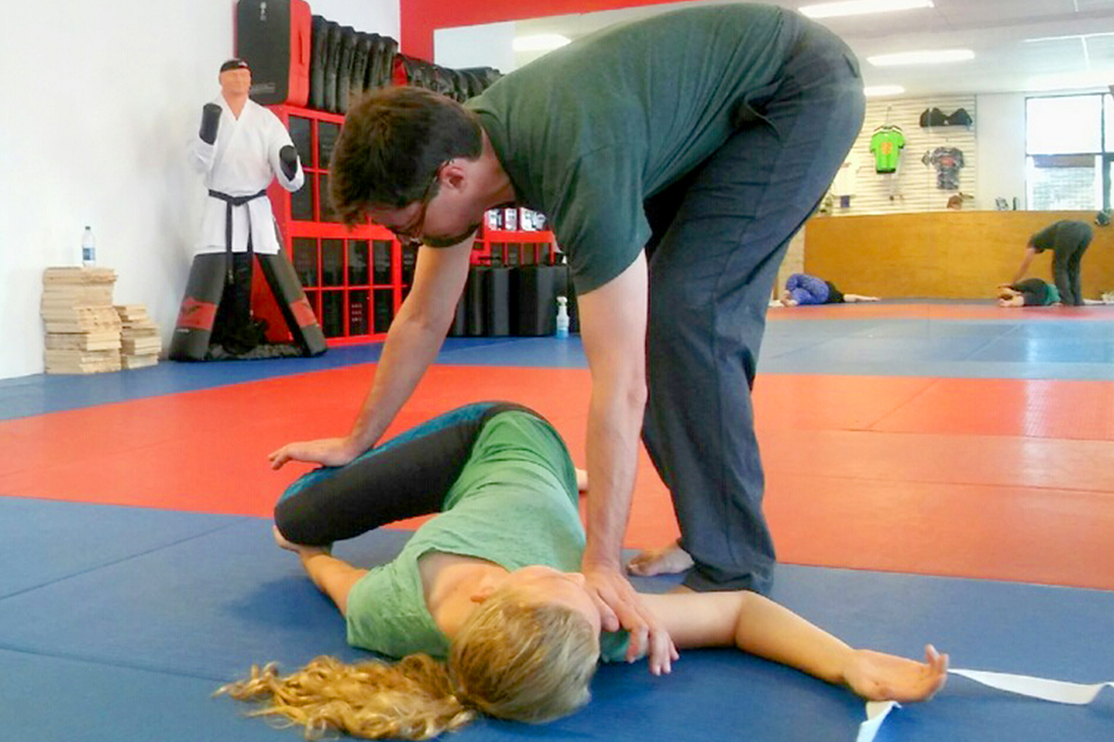 Justin Land at the Academy of Martial Arts, Naples (FL) teaching yoga.