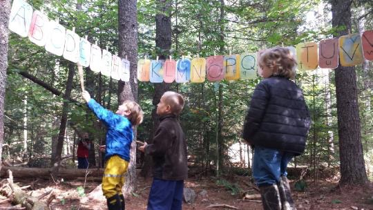 Learning the alphabet in an outdoor classroom