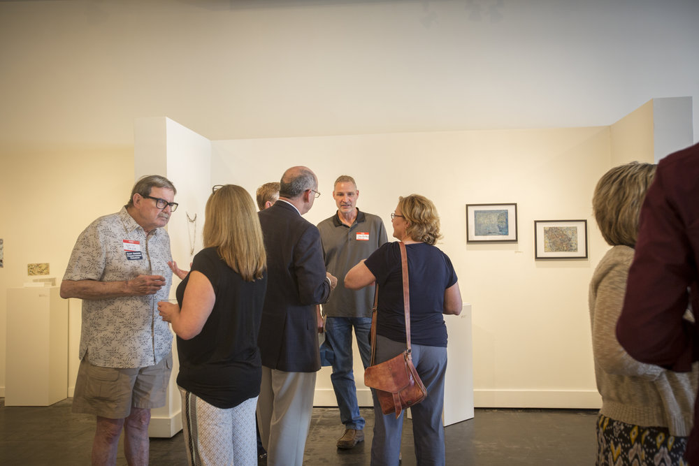 MSA Members connect over drinks among the beautiful art. Photo Cred: Tammi Paul