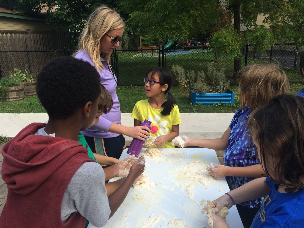 Miss Tori helps the Whittier students make fresh pasta in the school garden.