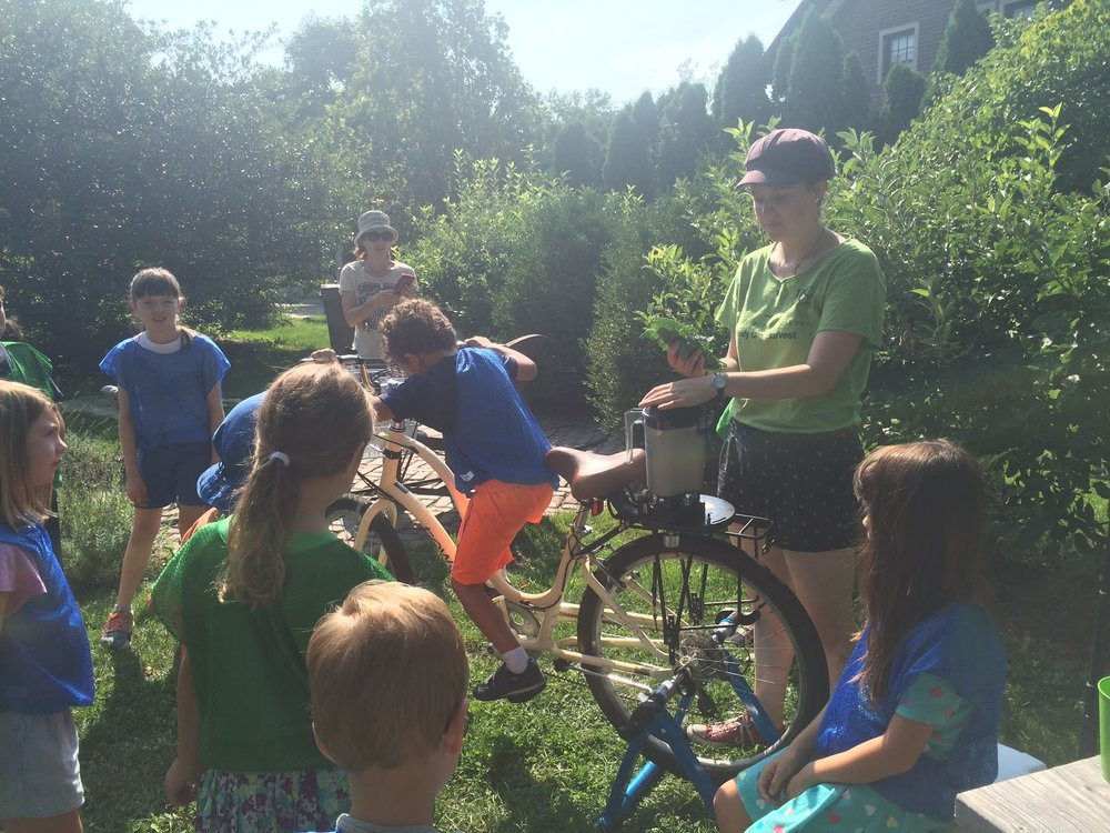 Audrey Roen, Blender Bike Program Director, overseeing kids making hummus.