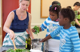 Cheryl Munoz teaching one of our first cooking classes at West Cook YMCA in 2015. Veggie Fried Rice!