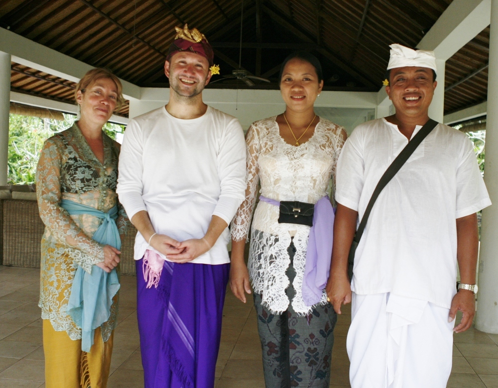 Intaba and Daniel with Balinese hosts, dressed and ready to go