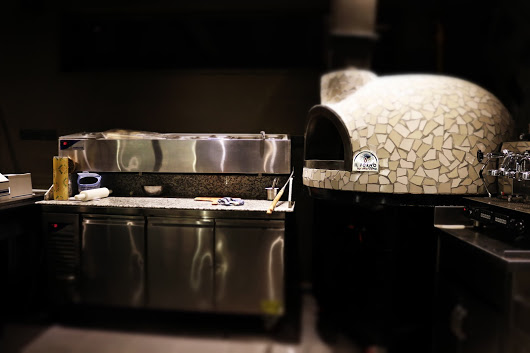 A makeline for making pizza and Il Forno By Marco gas fired oven with white mosaic finishing.