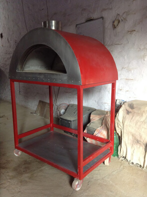 Mobile metal oven in red colour.