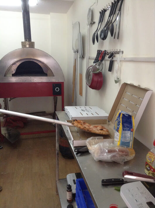 A delivery kitchen with an Il Forno By Marco metal oven in red colour.