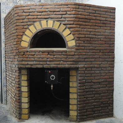 A straight wood fired oven with red bricks finishing.