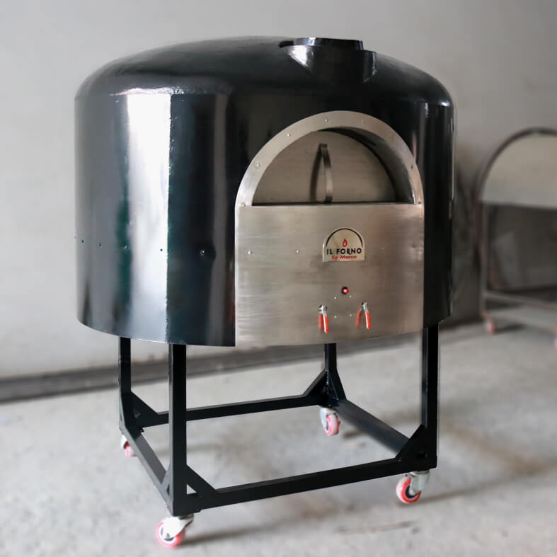 A large semi-mobile brick oven with gas burner system and a shelf for storing of wood. The oven has a metal steel shell that is painted black.