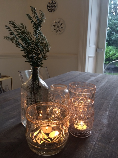 Vintage cut glass jars create pretty tea light holders for a party table