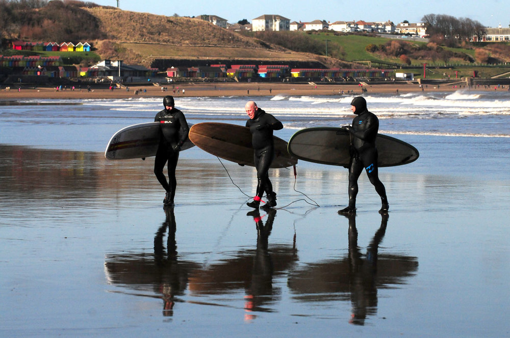 Learn to surf at Dexter's Surf School at The Sands