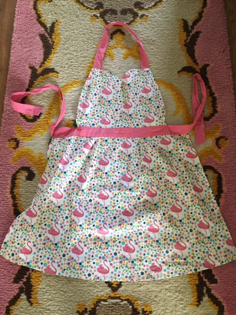 Flamingo pinny £8.99 from  Denby Pottery Factory shop