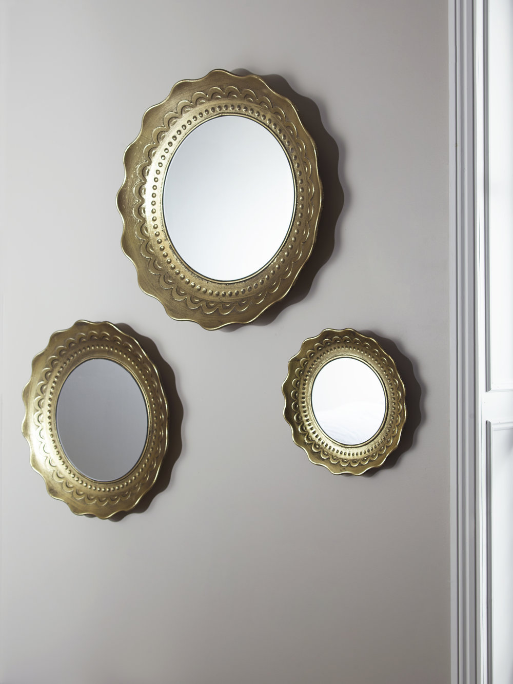 3 scollop edge mirror cluster £175  Cox and Cox