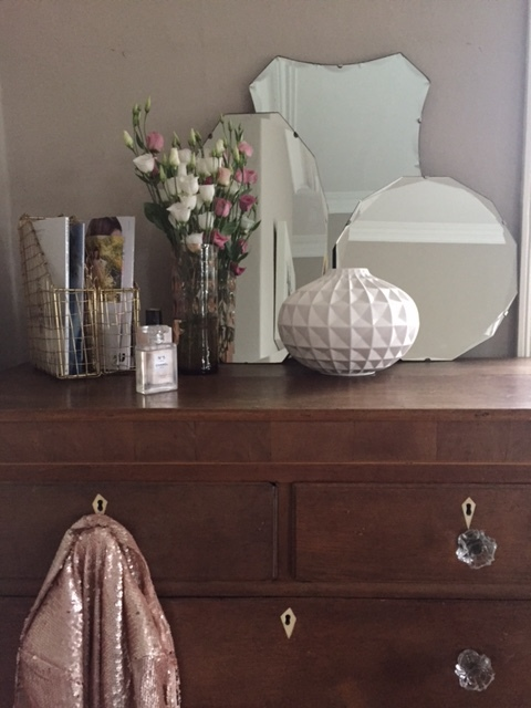 "Drawers, pink vase and mirrors are just a few of my ""vintage"" flea market trophies."
