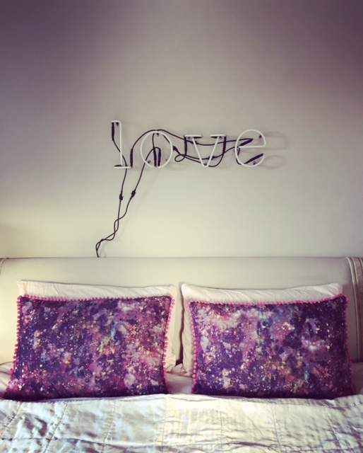 Bolster cushions made from Osmosis in Self Heal by Earthed Fabrics.