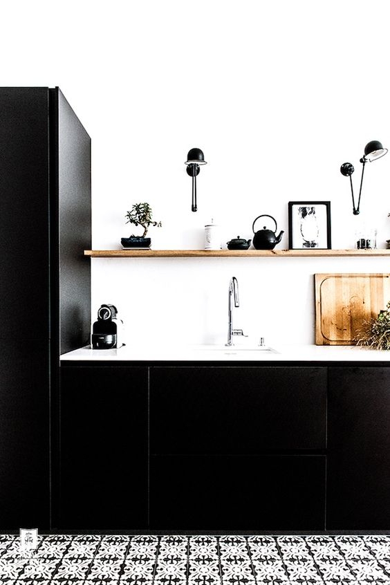 Black done the Parisian way in this chic apartment featured on French by Design Blog.