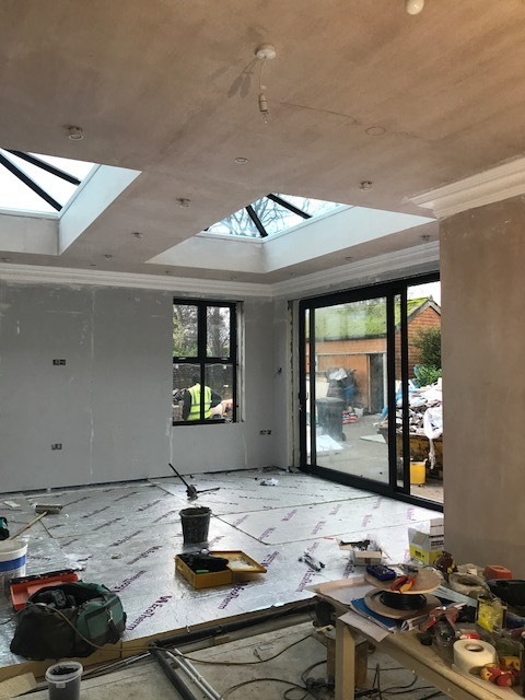 Aluminium roof lights, window and double sliding doors in the new extension.