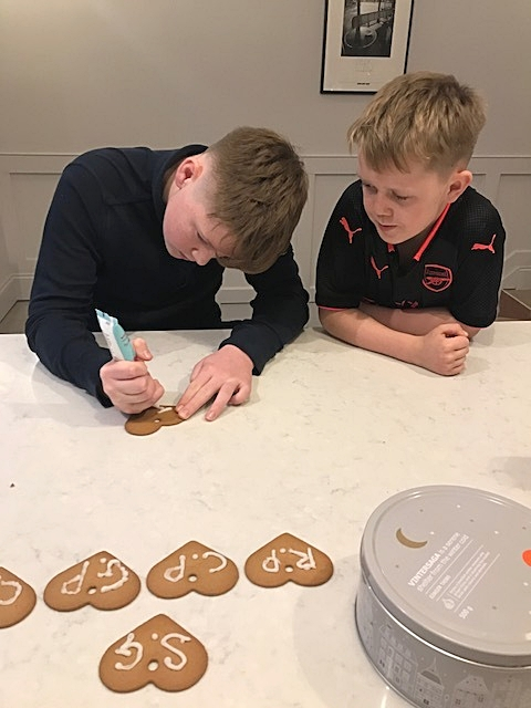 George and Charlie icing the edible place settings