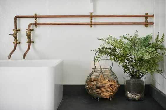 Utility chic wins for the boot room bathroom