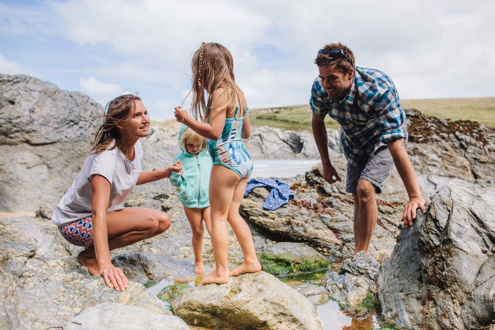 Family exploring the rock pools in Newquay for Beach Retreats-3 | Karl Mackie Photography