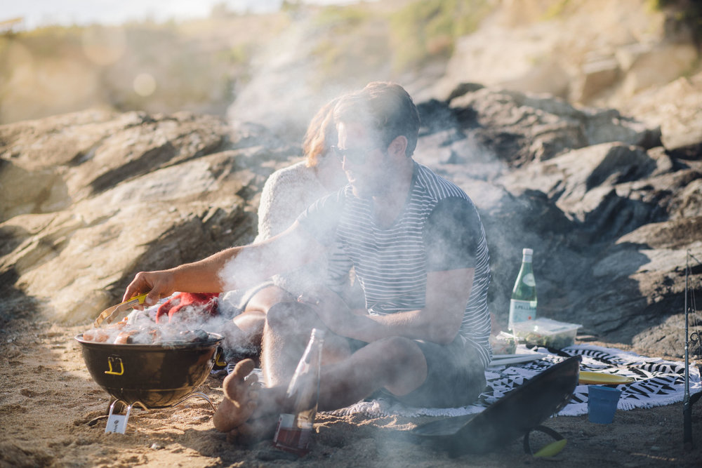 Couple cooking a beach barbie at Porth for Beach Retreats | Karl Mackie Photography