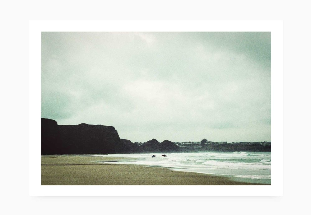 Surfers heading out at Watergate Bay | Karl Mackie Photography | Art Print