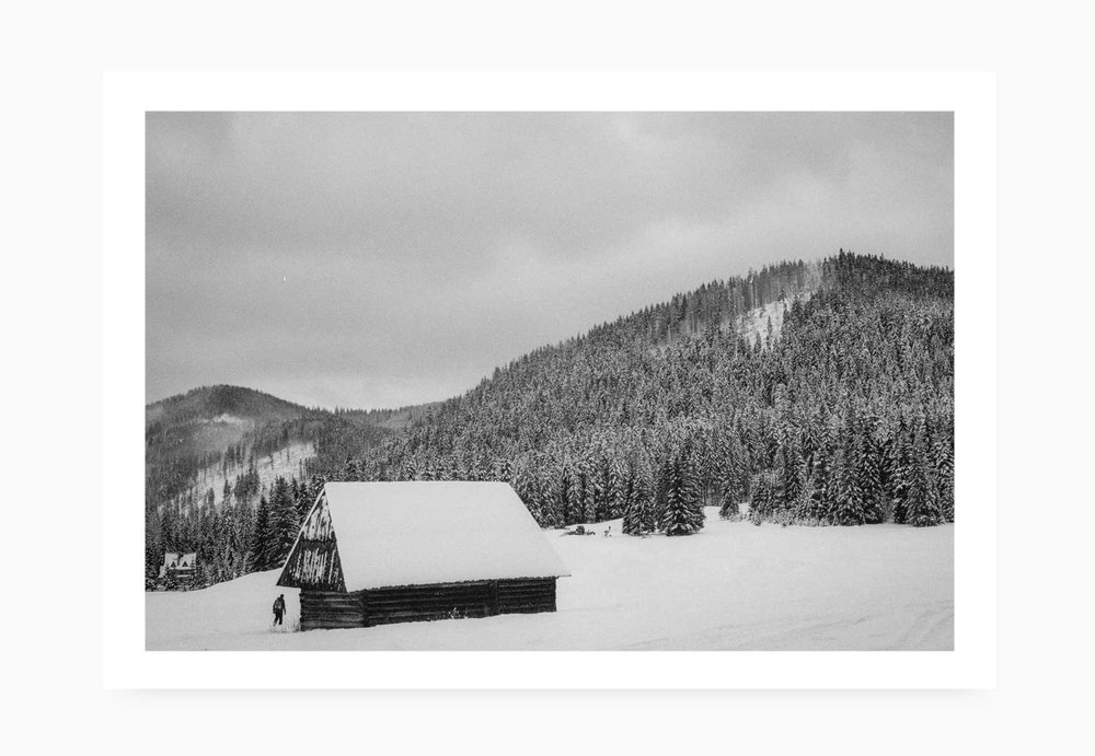 Lone cabin in the snow capped mountains | Karl Mackie Photography | Art Print