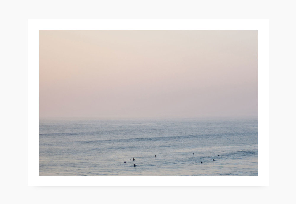 Surfers at sundown at Watergate Bay | Karl Mackie Photography | Art Print