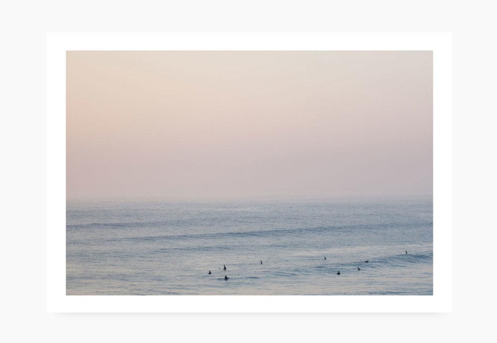 Surfers at sundown at Watergate Bay | Karl Mackie Photography | Art Print
