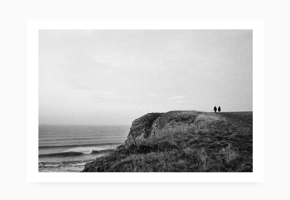 A couple walking the Watergate Bay Coastal path | Karl Mackie Photography | Art Print