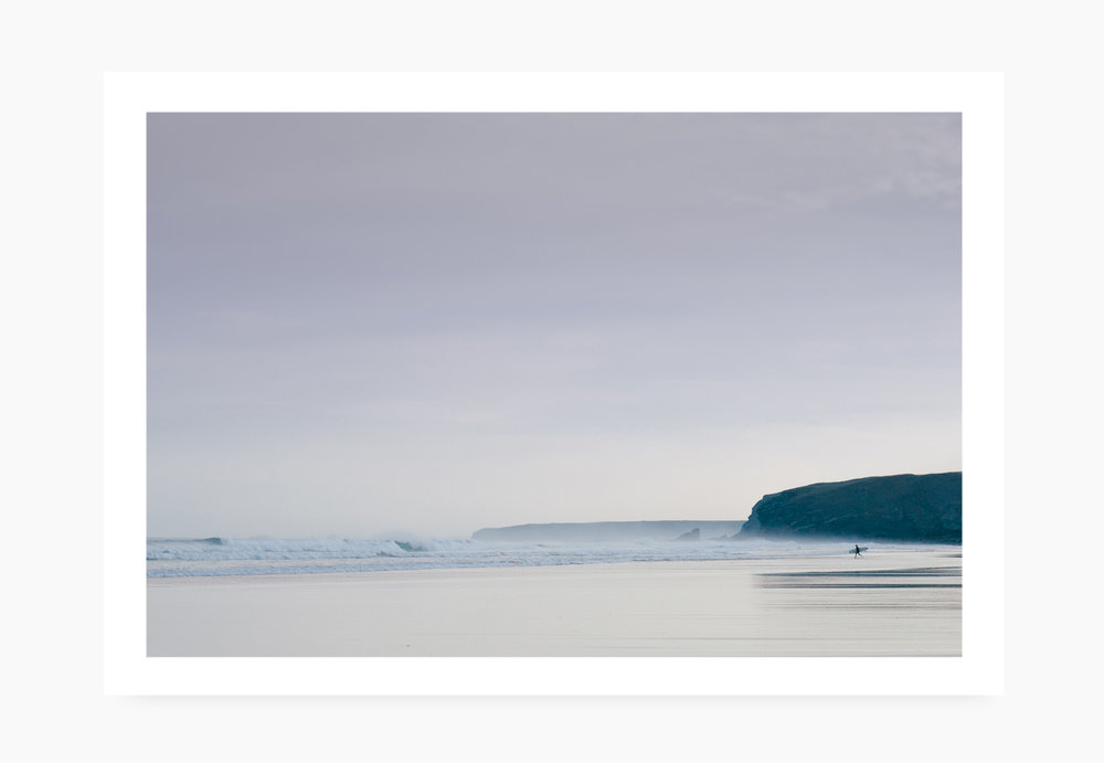 Surfer heading out at a misty Watergate Bay | Karl Mackie Photography | Art Print