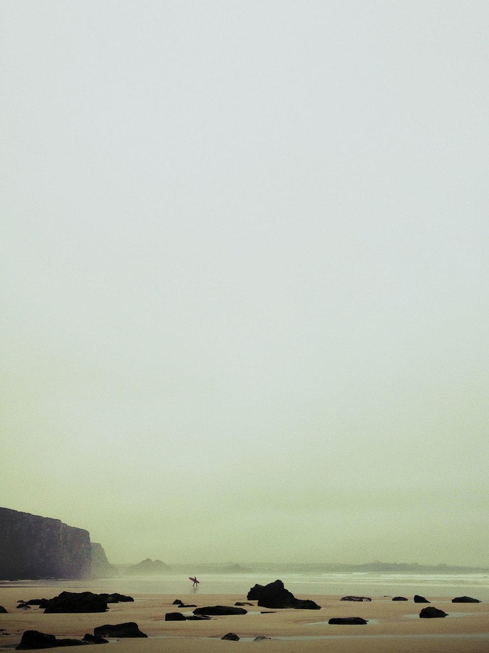 surfer-sand-cliffs-mist.jpg