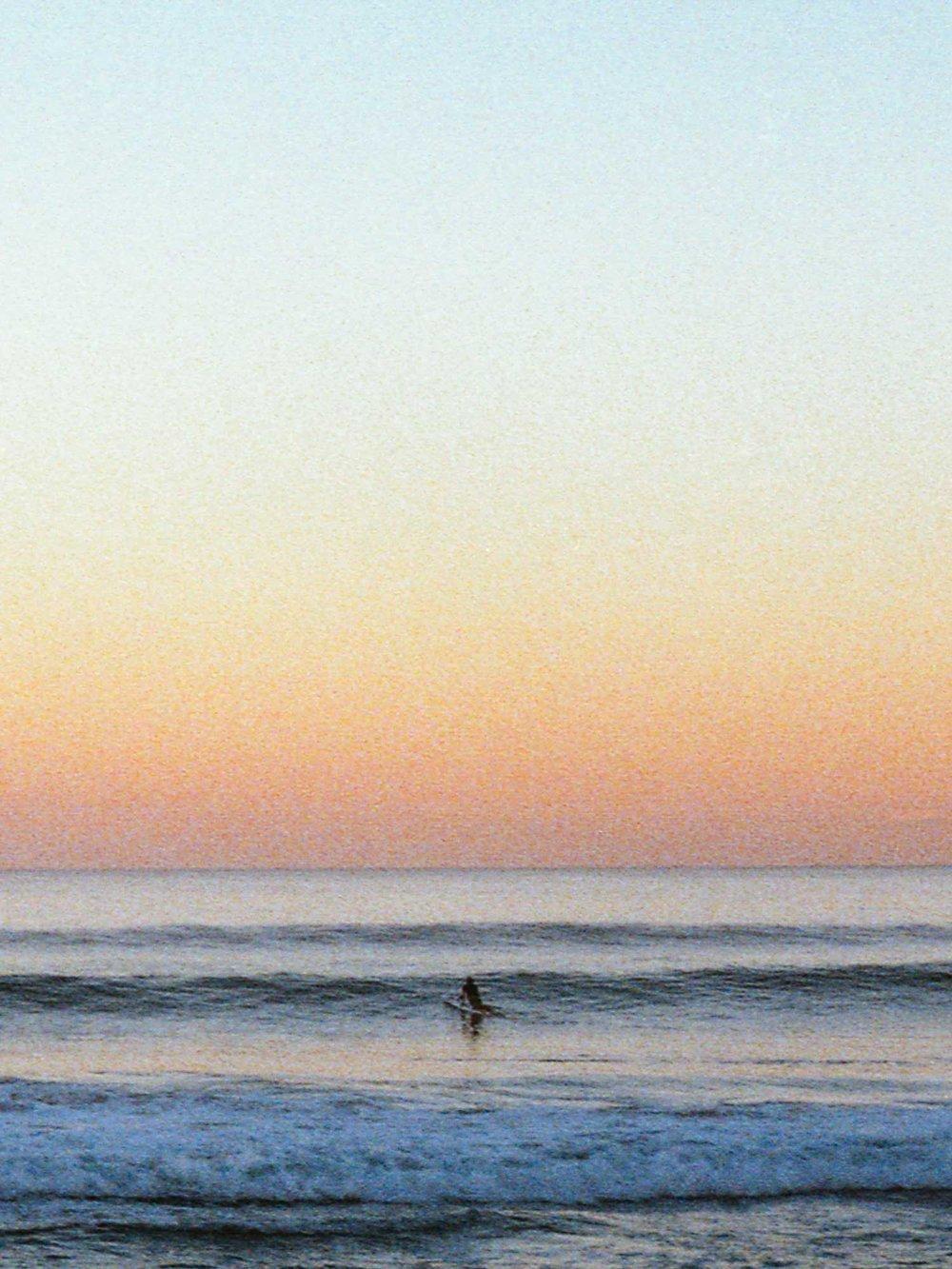 surfer-stretch-glassy-waves.jpg