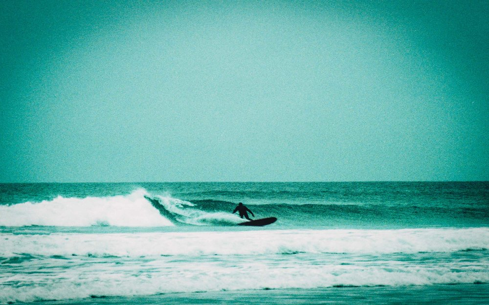 Surfer+bottom+turning+at+Watergate+Bay+_+Karl+Mackie+Photography.jpeg