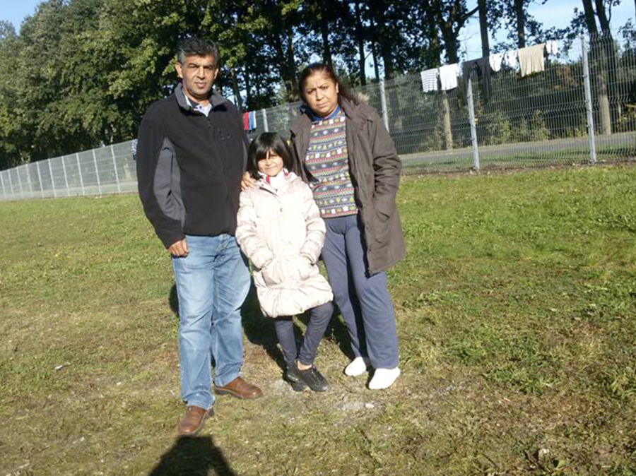 Mohamad and his wife and children, reunited in Germany.