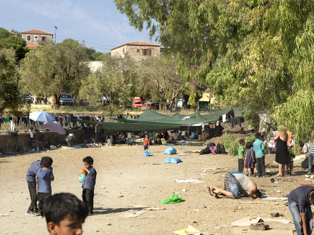 The parking lot where refugees were required to wait for a bus who would take them to Mythilini. It was 35 C and there was barely shadow.
