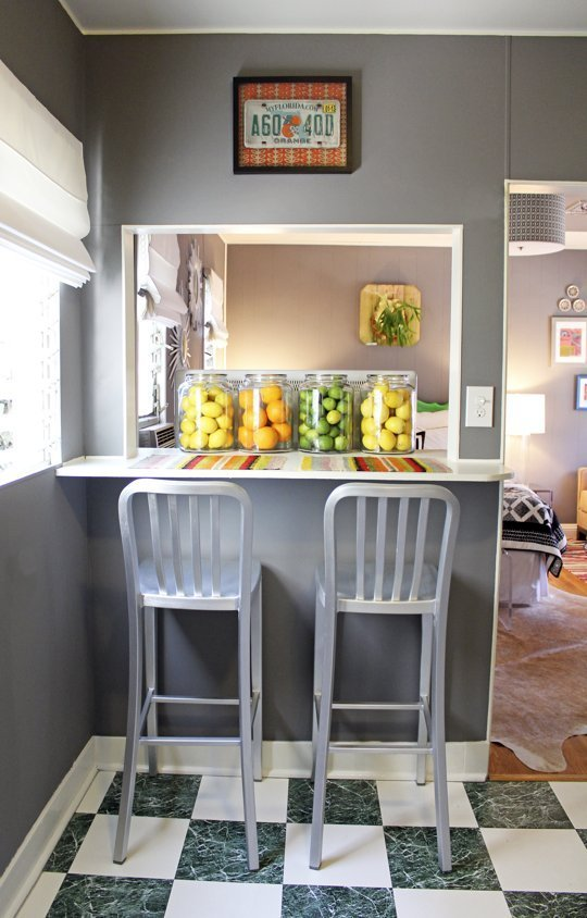 This peak-a-boo counter keeps your dining options open, airy, and functional. Photo via Houzz.