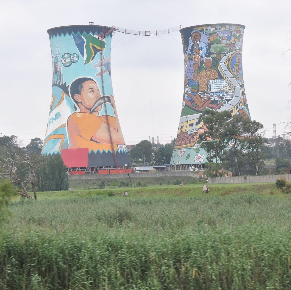 Twin stacks of a closed power plant now depict the history of South Africa
