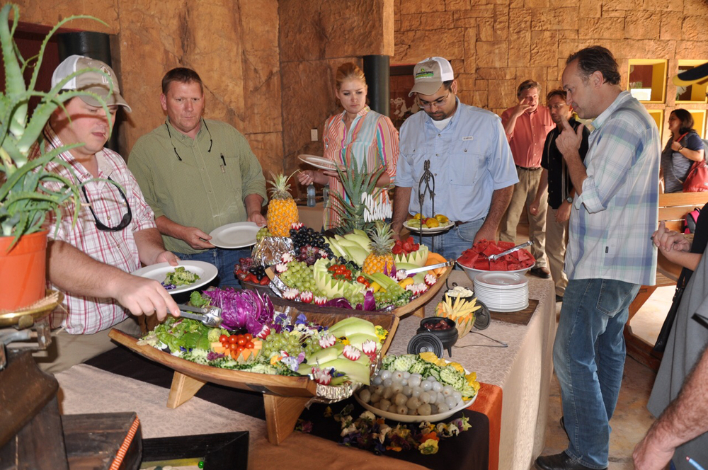 Class members Lance Bruce, Chip Hixon, Kassi Berard, Brandon Dubois, and Billy Patout, Jr. survey a colorful feast at Inyoni Crocodile Estate.