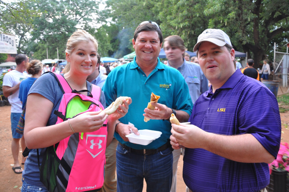 Kassie Berard, Troy Romero, Lance Bruce enjoy cinnamon and sugar crêpes.