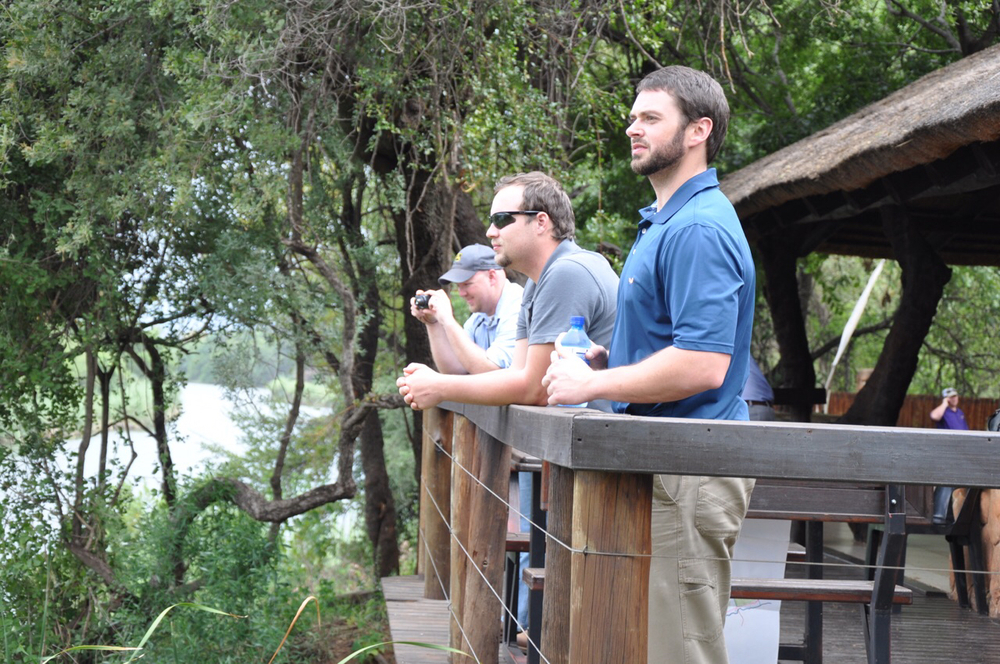From right to left: Zach Hankins, Clint Galiano, and Heath Gajan check out the Elan River in the Wolf's Rock Lodge in Witbank.