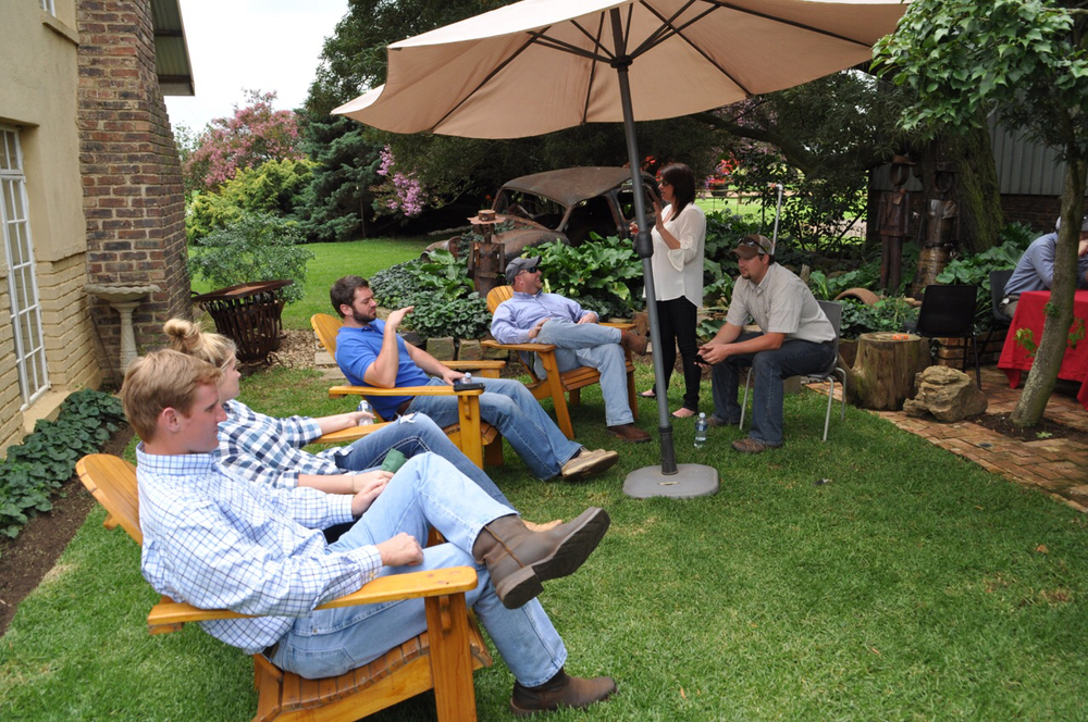 From left to right: Patrick Frischhertz, Kassie Berard, Zach Hankins, Heath Gajan, Hester Bourdier and Clint Galiano enjoy a garden party at the Roos family home.
