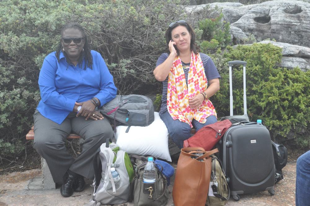 Dr. Gina Eubanks and our tour guide Manuela Daniel relax for a minute on Table Mountain.