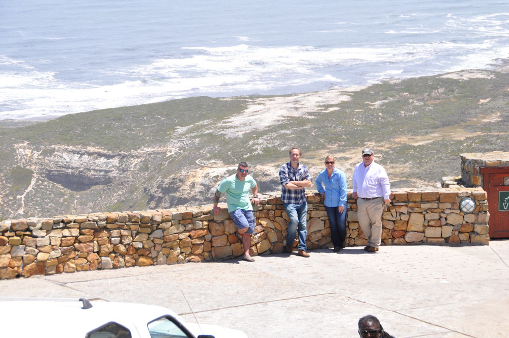 Trey Gingles, Billy Patout, Leigh Godchaux, and Lance Bruce overlook the surf at the Cape Point Lighthouse.