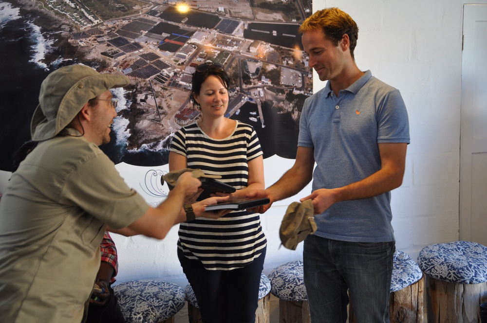 Dr. Chris Green presents LSU gifts to Heart of Abalone Tours owner Johan Hugo and tour guide Mathilde Le Riche after the tour.