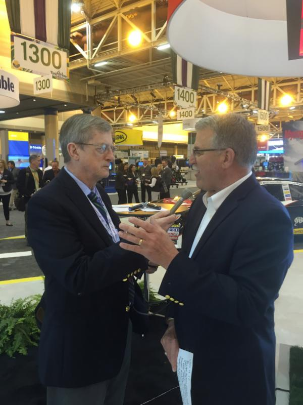 Don Molino visits with Keith Porter of Dow Agro Sciences
