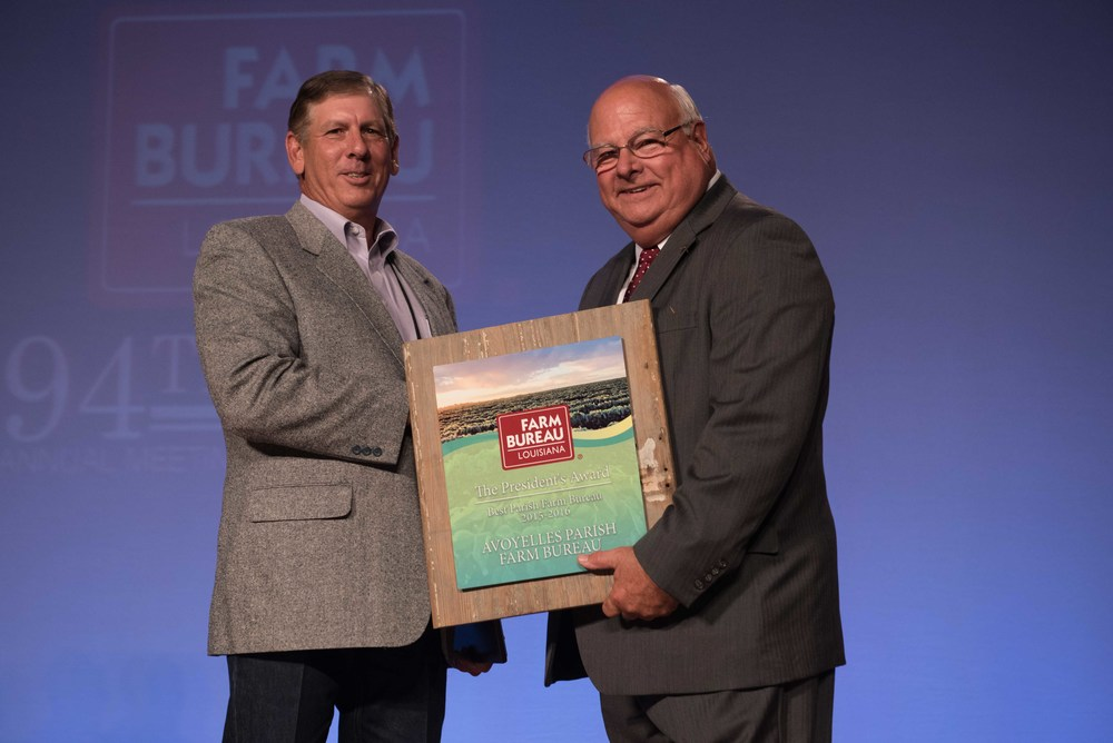 Phillip Lemartiniere, left, president of Avoyelles Parish, accepts the 2016 President's Trophy from Louisiana Farm Bureau President Ronnie Anderson, right.  Avoyelles Parish has won the top honor given out at the Louisiana Farm Bureau for an unprecedented four years in a row.
